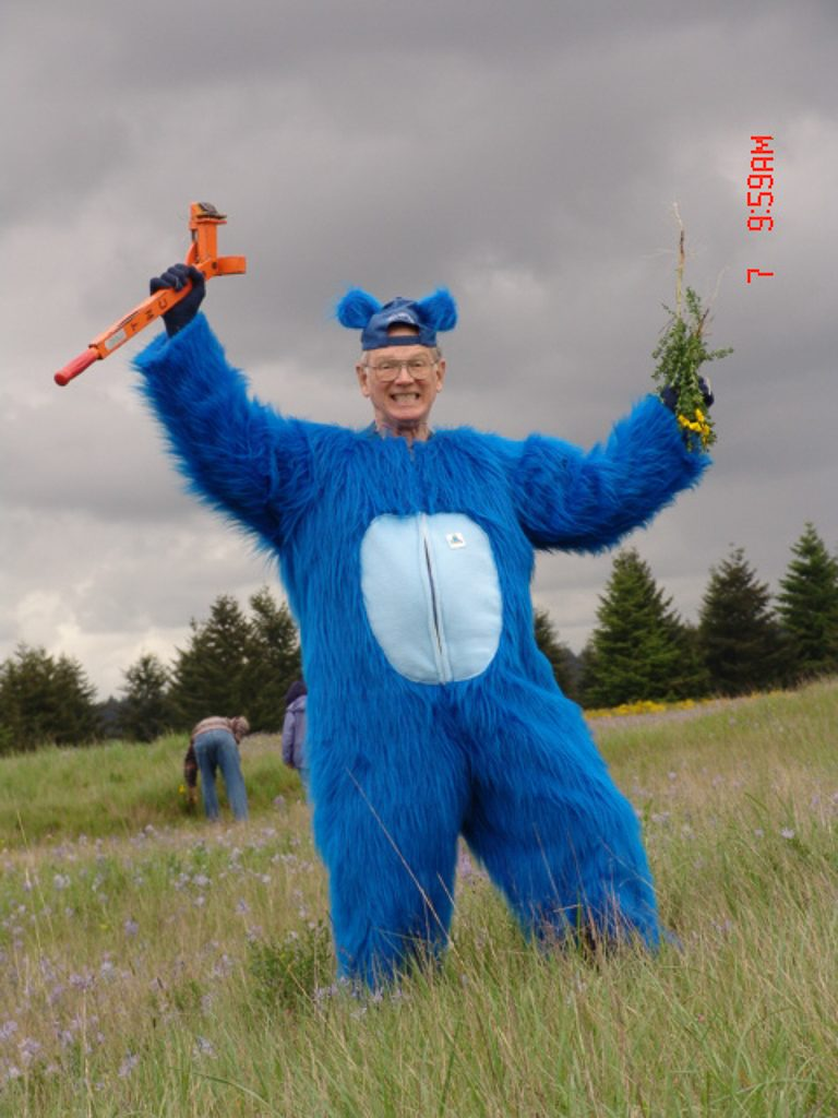 Cliff Snyder, who always loves a good story, used totell people the mounds were made by prehistoric Blue Gophers.  I jokingly suggested we make him dress up like one for PAD.  Marion Jarisch tooke me seriously and made him the suit and he wore it every PAD for years.  Photo by Margaret Allen