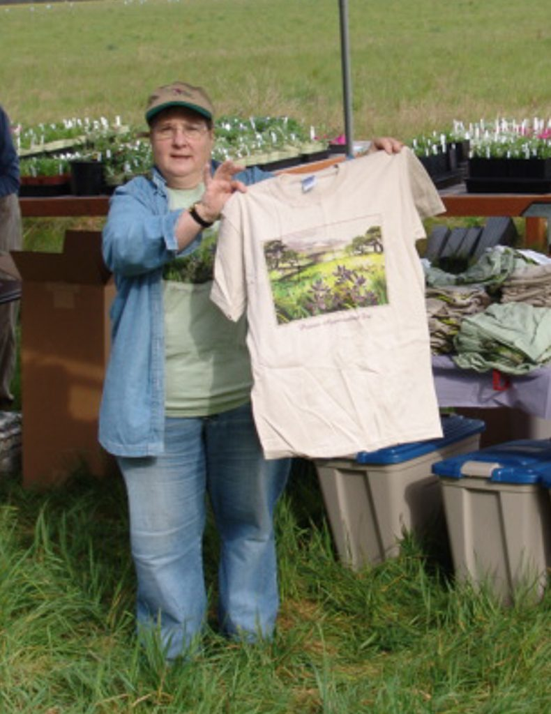 Kathy showing off a Prairie Appreciation Day T-shirt, Photo by Margaret Allen