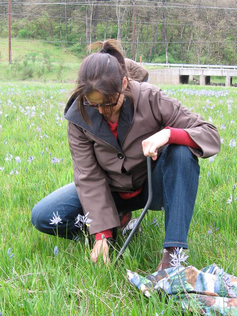 Elizabeth Campbell demonstrating the use of a digging stick.