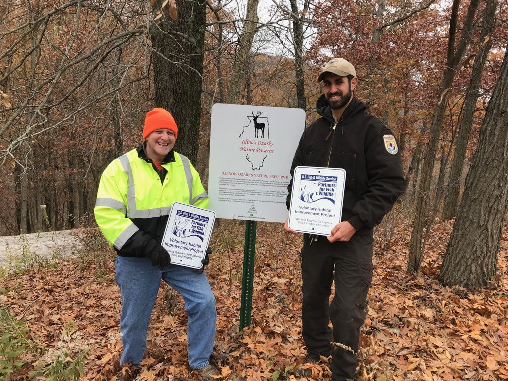 Nick George (USFWS Biologist) stands with a proud landowner after the completion of a project; Photo Credit: Debbie Newman/Illinois Natural Heritage