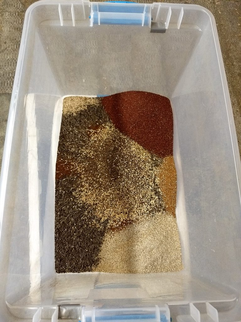 A Selection of Seeds to Be mixed with Fescue for Seeding after a Burn.  Photo by Ivy Clark.